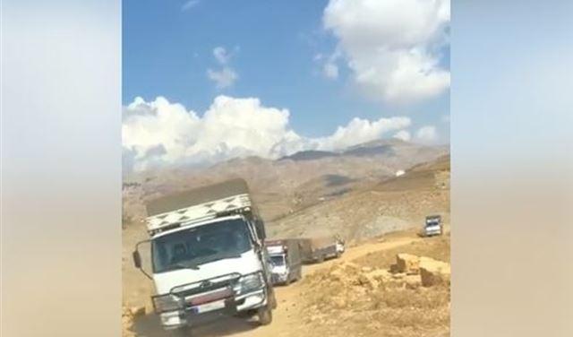 وزارة الدفاع توضح حقيقة فيديو الشاحنات التي تنقل البضائع