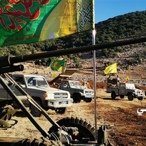 بالصور: عناصر حزب الله يحيون ذكرى دينية