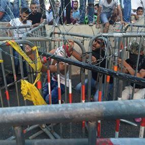بالصور.. مواجهات بين القوى الامنية والمتظاهرين